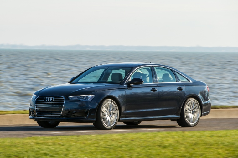 Driving 2018 Audi A6 2.0T quattro Sedan in Moonlight Blue Metallic from a front left three-quarter view