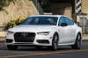 Driving 2017 Audi A7 Sportback in Glacier White from a front left view