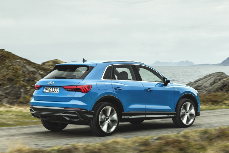 Driving 2020 Audi Q3 45 quattro in Turbo Blue from a rear right three-quarter view