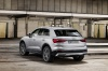 2020 Audi Q3 45 quattro in Florett Silver Metallic from a rear left view