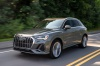 Driving 2020 Audi Q3 45 quattro in Nano Gray Metallic from a front left three-quarter view