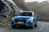 Driving 2020 Audi Q3 45 quattro in Turbo Blue from a frontal view