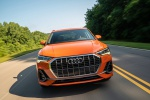 Picture of a driving 2020 Audi Q3 45 quattro in Pulse Orange from a frontal perspective