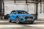 Picture of a 2020 Audi Q3 45 quattro in Turbo Blue from a front right perspective