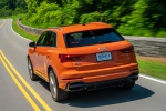 Picture of a driving 2020 Audi Q3 45 quattro in Pulse Orange from a rear left perspective