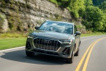 Picture of a driving 2020 Audi Q3 45 quattro in Nano Gray Metallic from a front left perspective