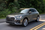Picture of a driving 2020 Audi Q3 45 quattro in Nano Gray Metallic from a front left three-quarter perspective