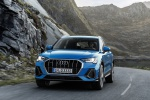 Picture of a driving 2020 Audi Q3 45 quattro in Turbo Blue from a frontal perspective