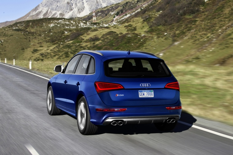 Driving 2017 Audi SQ5 Quattro in Sepang Blue Pearl Effect from a rear left view