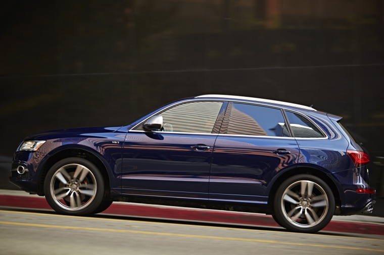 Driving 2017 Audi SQ5 Quattro in Sepang Blue Pearl Effect from a side view