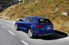 Driving 2017 Audi SQ5 Quattro in Sepang Blue Pearl Effect from a rear left three-quarter view