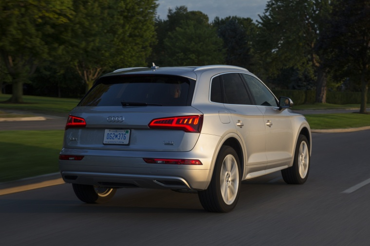 Driving 2018 Audi Q5 quattro in Florett Silver Metallic from a rear right view
