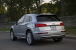 Picture of a driving 2018 Audi Q5 quattro in Florett Silver Metallic from a rear left perspective