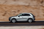 Picture of a driving 2019 Audi Q5 quattro in Florett Silver Metallic from a left side perspective