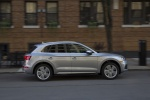Picture of a driving 2019 Audi Q5 quattro in Florett Silver Metallic from a right side perspective