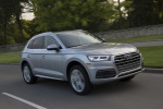 Picture of a driving 2019 Audi Q5 quattro in Florett Silver Metallic from a front right three-quarter perspective