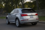Picture of a driving 2019 Audi Q5 quattro in Florett Silver Metallic from a rear left perspective