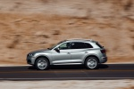 Picture of a driving 2020 Audi Q5 45 TFSI quattro in Florett Silver Metallic from a left side perspective
