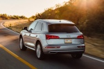 Picture of a driving 2020 Audi Q5 45 TFSI quattro in Florett Silver Metallic from a rear left perspective