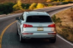 Picture of a driving 2020 Audi Q5 45 TFSI quattro in Florett Silver Metallic from a rear perspective