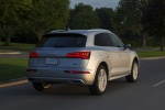 Picture of a driving 2020 Audi Q5 45 TFSI quattro in Florett Silver Metallic from a rear right perspective