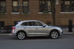 Picture of a driving 2020 Audi Q5 45 TFSI quattro in Florett Silver Metallic from a right side perspective