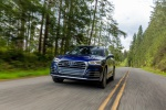 Picture of a driving 2020 Audi SQ5 quattro in Navarra Blue Metallic from a front left perspective