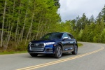 Picture of a driving 2020 Audi SQ5 quattro in Navarra Blue Metallic from a front left three-quarter perspective