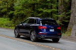 Picture of a driving 2020 Audi SQ5 quattro in Navarra Blue Metallic from a rear left three-quarter perspective