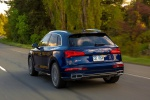 Picture of a driving 2020 Audi SQ5 quattro in Navarra Blue Metallic from a rear left perspective