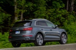 Picture of a driving 2020 Audi SQ5 quattro in Daytona Gray Pearl Effect from a rear right three-quarter perspective