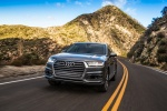 Picture of a driving 2018 Audi Q7 3.0T quattro in Graphite Gray Metallic from a front left perspective