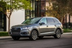 Picture of a driving 2018 Audi Q7 3.0T quattro in Graphite Gray Metallic from a front left three-quarter perspective