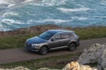 Picture of a driving 2018 Audi Q7 3.0T quattro in Graphite Gray Metallic from a front left three-quarter top perspective