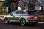 Picture of a driving 2018 Audi Q7 3.0T quattro in Graphite Gray Metallic from a rear left three-quarter perspective