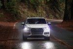 Picture of a driving 2018 Audi Q7 3.0T quattro in Glacier White Metallic from a frontal perspective