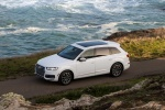 Picture of a driving 2018 Audi Q7 3.0T quattro in Glacier White Metallic from a front left three-quarter perspective