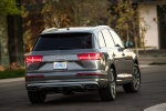 Picture of a driving 2018 Audi Q7 3.0T quattro in Graphite Gray Metallic from a rear right perspective