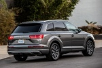 Picture of a driving 2018 Audi Q7 3.0T quattro in Graphite Gray Metallic from a rear right three-quarter perspective
