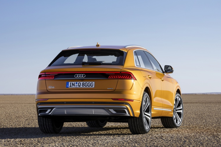 2019 Audi Q8 Premium 55 TFSI quattro in Dragon Orange Metallic from a rear right view