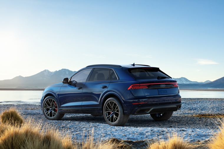 2019 Audi Q8 Premium 55 TFSI quattro in Galaxy Blue Metallic from a rear left three-quarter view