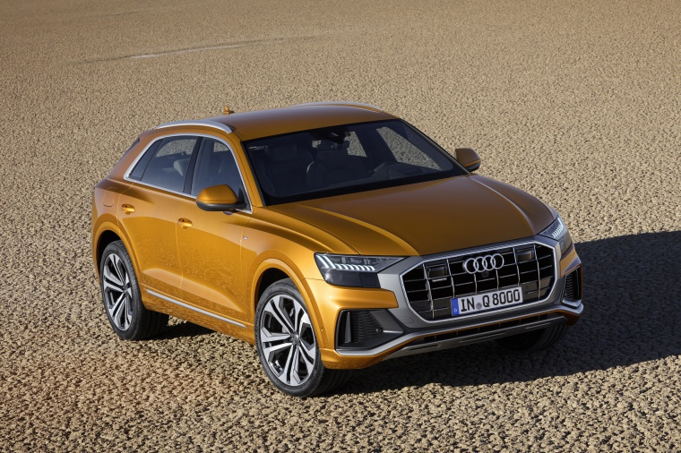 2019 Audi Q8 Premium 55 TFSI quattro in Dragon Orange Metallic from a front right three-quarter view