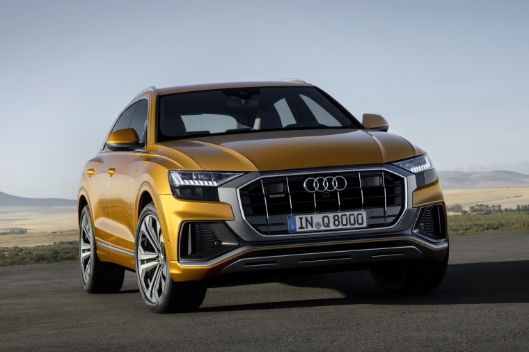 2019 Audi Q8 Premium 55 TFSI quattro in Dragon Orange Metallic from a front right view