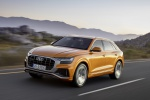 2019 Audi Q8 Premium 55 TFSI quattro in Dragon Orange Metallic - Driving Front Left Three-quarter View