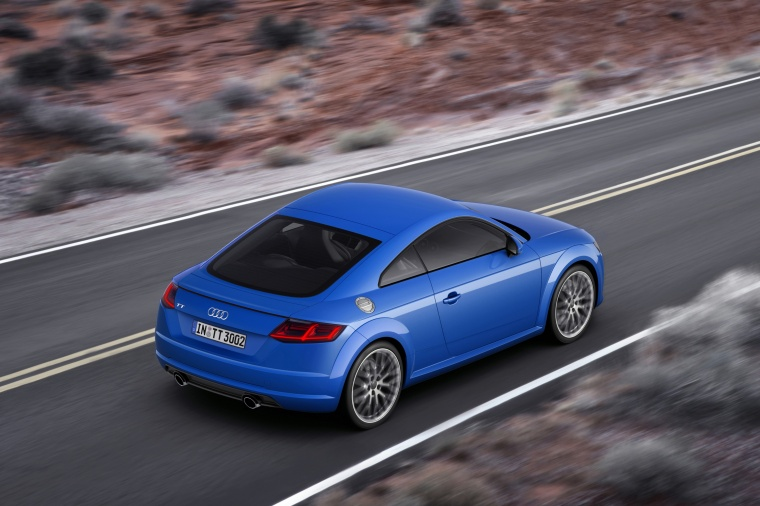 Driving 2018 Audi TT Coupe in Scuba Blue Metallic from a rear right three-quarter view