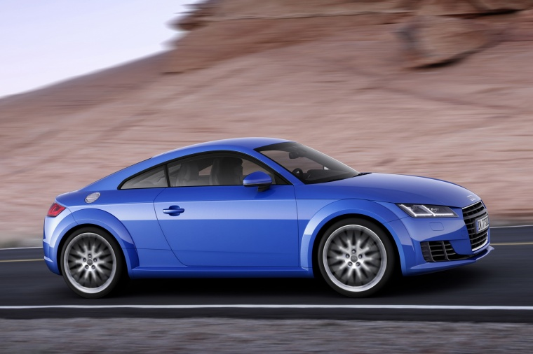 Driving 2018 Audi TT Coupe in Scuba Blue Metallic from a side view