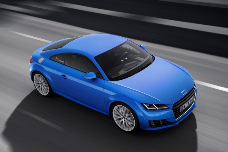 Driving 2018 Audi TT Coupe in Scuba Blue Metallic from a front right three-quarter view