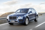 Picture of a driving 2019 Bentley Bentayga in Sequin Blue from a front left three-quarter perspective