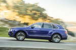 Picture of a driving 2019 Bentley Bentayga in Sequin Blue from a side perspective