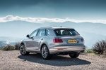 Picture of a 2019 Bentley Bentayga in Silver Storm Metallic from a rear left perspective